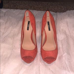 Coral colored peep toe pumps